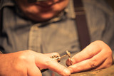 Jeweler polishes the ring