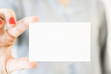 Woman holding white business card mockup - 182876493