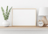 Home interior poster mock up with horizontal metal frame, plant in vase and lamp on white wall background. 3D rendering. - 182876893