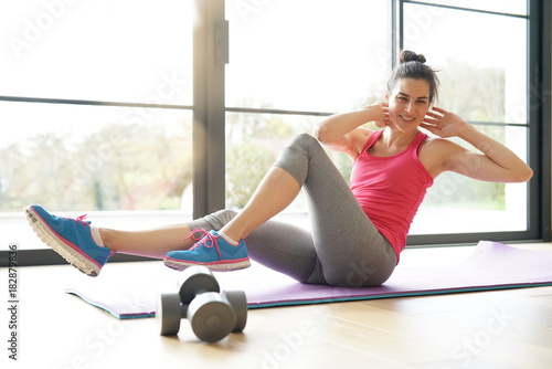 Plexiglas Fitness Woman doing fitness exercises at home