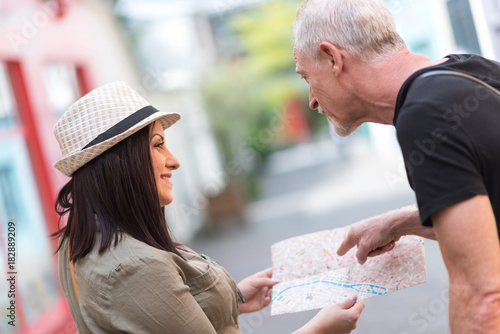 Pretty young woman asking for direction