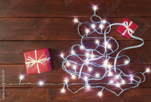 Luminous garland in the form of Christmas tree and gift boxes