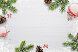Flat Christmas background scene with fir branches, bows, candles, pinecones and snowflakes Free space for copy text on white board. Top view.
