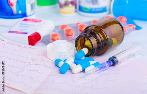Foto op Plexiglas Apotheek Drug prescription for treatment medication. Pharmaceutical medicament, cure in container for health. Pharmacy theme, capsule pills with medicine antibiotic in packages.