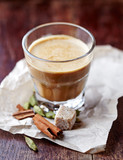 Aromatic coffee with milk and spices - 182910440