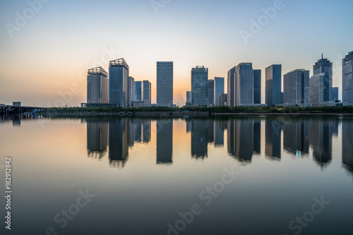 urban skyline and modern buildings at dusk, cityscape of China.. Poster