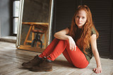 indoor portrait of beautiful young redhead woman dressed in hipster style - 182933292