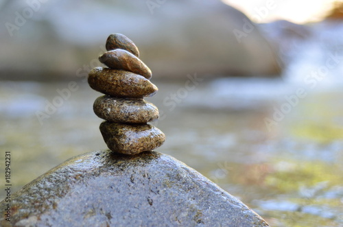 Foto op Plexiglas Stenen in het Zand Zen stones stack from large to small on the river