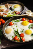 fried eggs with vegetables - 182942422