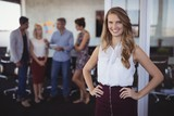 Portrait of smiling young businesswoman standing at creative - 182944041