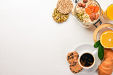 Healthy Diet Breakfast. Nuts, oat flakes, fruits, croissants, on a wooden surface. Top view. Free space for text. - 182944080