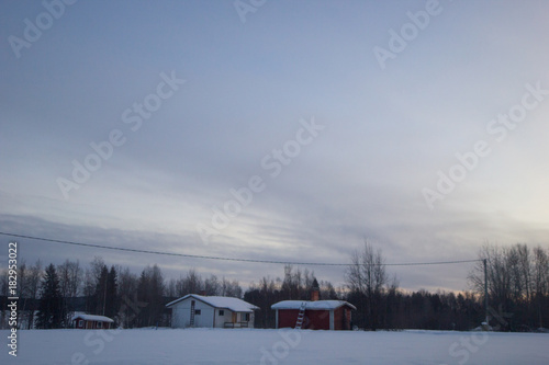 Sunrise in the winter landscape of Lapland Poster