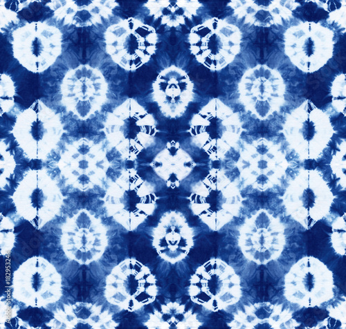 Cotton fabric Seamless pattern, abstract tie dyed fabric of indigo color on white cotton. Hand painted fabrics. Shibori dyeing