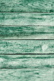 Old green shabby wooden planks with cracked color paint - 182954299