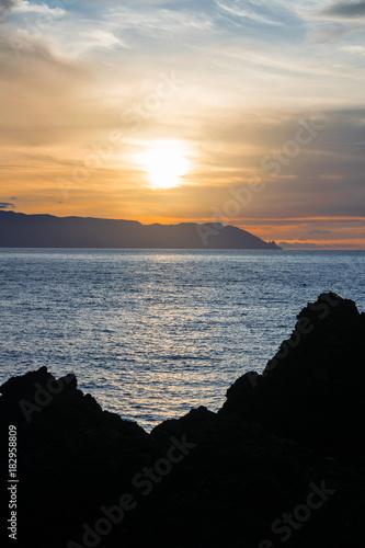 Deurstickers Zee zonsondergang Sunset over La Gomera , view from Teno, Tenerife