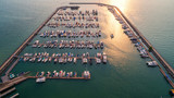 Pier speedboat. A marina lot. This is usually the most popular tourist attractions on the beach.Yacht and sailboat is moored at the quay.Aerial view by drone.Top view. - 182961825