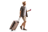 Tourist with a passport and a suitcase walking - 182964489