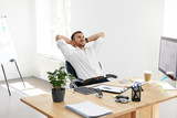 Worker Relaxing In Office. Relaxed Man At Work