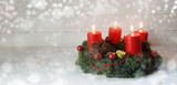 Advent wreath with four red burning candles and christmas decoration on rustic white wood, bokeh lights and blurred snow, panorama format with copy space, - 182966001
