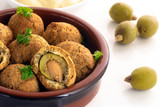 baked olives in a dough coat with parmesan cheese, party finger food, spanish tapas appetizer in a typical brown ceramic bowl on a white table, close up - 182966211