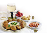 appetizers and a glass of white wine, spanish tapas such as baked olives, prawn shrimps, potatoes, tomato and garlic sauce as a corner background on white with copy space - 182966444