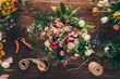 top view of bouquet of pink and white roses on florist table