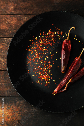 Tuinposter Hot chili peppers Chili pepper with seeds on a plate