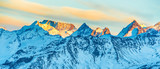 Mountains peaks with snow at sunset, panorama landscape