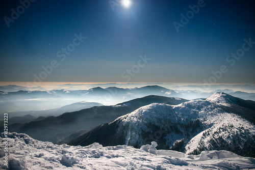 Staande foto Bleke violet Mountains in snow at night sky