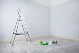 Painted White Room With Ladder And Painting Equipments - 182974045