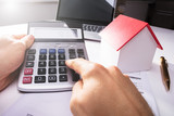 Businessman Using Calculator - 182977661