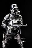 Futuristic  soldier gas mask and steel helmet with schmeisser handgun black background studio shot - 182981065