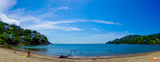 Beautiful panoramic view of Taganga, the caribbean coast with some tourists enjoying the sunny day in Colombia
