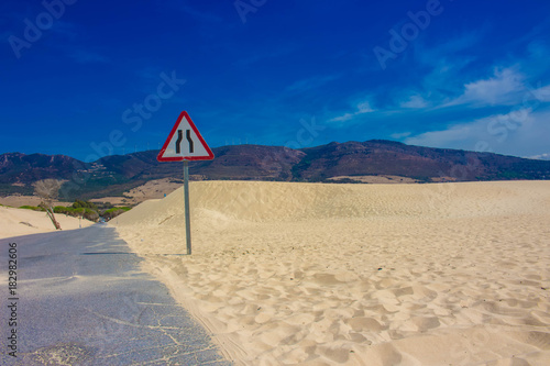 Tuinposter Beige Road. White ocean sand, dunes. Punta Paloma beach, Tarifa, Spain.