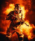 Futuristic soldier in fire and smoke gas mask and steel helmet with schmeisser handgun - 182984035