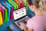 Woman Shopping Online Using Laptop - 182985629