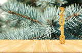 Golden vertical number 2018 on wooden floor against the background of pine branches. 3D illustration - 182991014