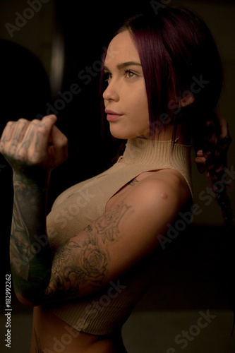Portrait of a punk girl with purple hair. close up