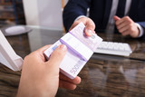 Businessperson Taking Bribe In Office
