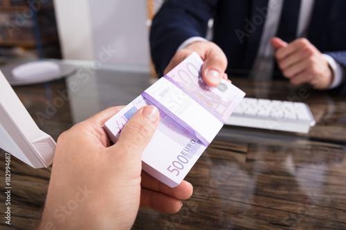 Fototapeta Businessperson Taking Bribe In Office