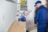 Two Movers Unloading Furniture From Truck - 182997459