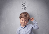 Smart kid in front of a drawn up grey wall - 182999608