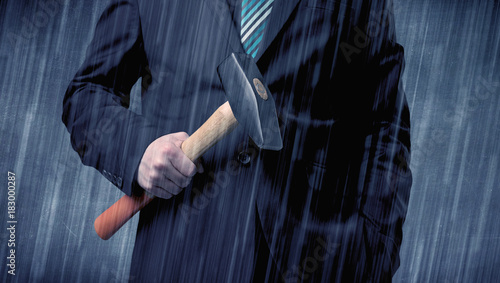 Employer standing with tool on his hand