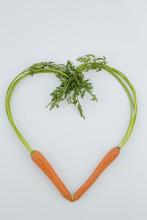 """Постер, картина, фотообои """"fresh carrots in heart shape"""""""