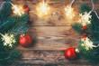 Christmas greeting card, fir branches, light garland, berries