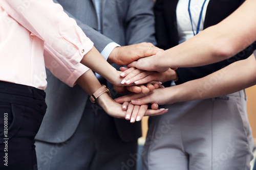 Wall mural Business people joining hands