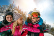 young family with children on winter ski vacation
