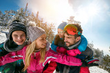 young family with children on winter ski vacation - 183034841