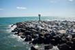 Sea wall or breakwater built of natural rocks