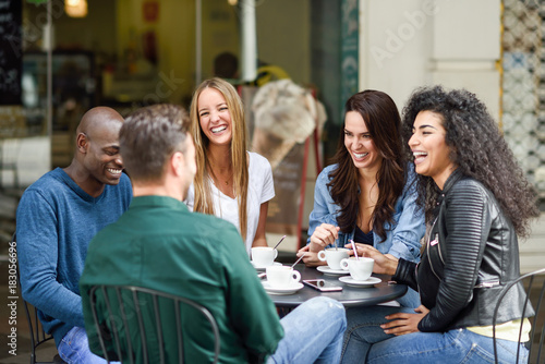 Sticker Multiracial group of five friends having a coffee together